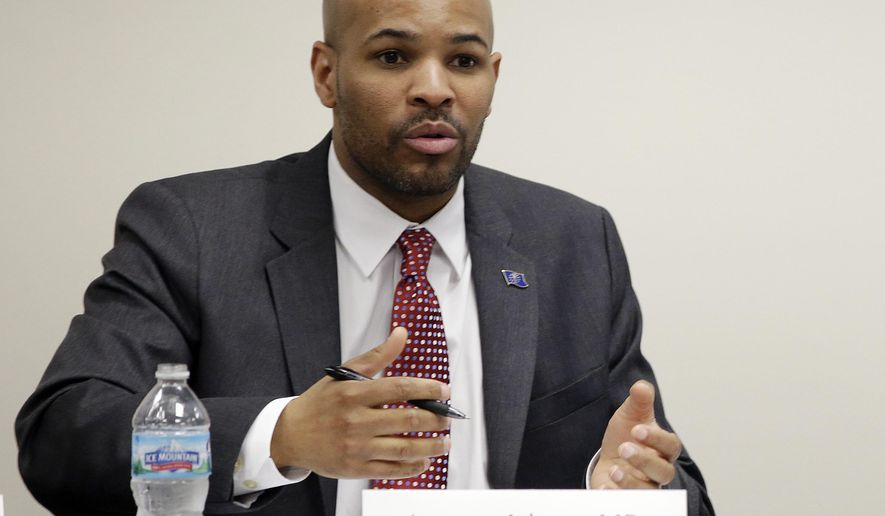 FILE - In this March 25, 2015, file photo Indiana State Health Commissioner Dr. Jerome Adams speaks in Scottsburg, Ind. President Donald Trump on June 29, nominated Adams to serve as the next U.S. Surgeon General, selecting an anesthesiologist who promoted needle-exchange programs while serving under Vice President Mike Pence. (AP Photo/Darron Cummings, File)