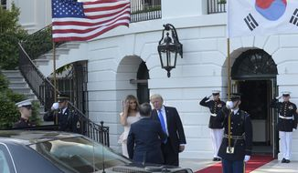 President Donald Trump and first lady Melania Trump welcome South Korean President Moon Jae-in to the White House in Washington, Thursday, June 29, 2017. (AP Photo/Susan Walsh)