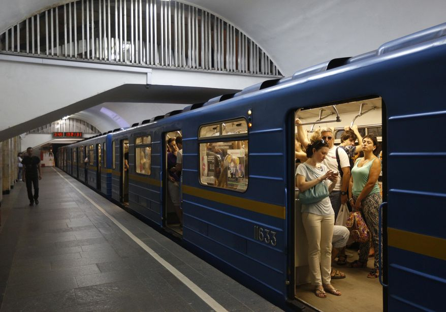 Passengers use mobile phones in an underground in Kiev, Ukraine, Wednesday, June 28, 2017.  The cyberattack ransomware that has paralysed computers across the world hit Ukraine hardest Tuesday, with victims including top-level government offices, energy companies, banks, cash machines, gas stations, and supermarkets. (AP Photo/Sergei Chuzavkov)