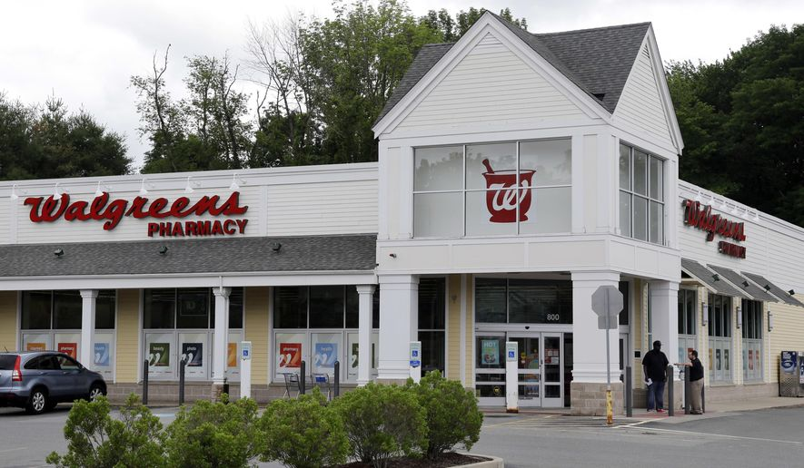 This Tuesday, July 5, 2016, file photo shows a Walgreens drugstore in North Andover, Mass. Walgreens will replace General Electric on the Dow Jones Industrial Average before the open of trading on the morning of June 26, 2018. (AP Photo/Elise Amendola, File)