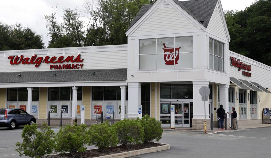 FILE - This Tuesday, July 5, 2016, file photo shows a Walgreens drugstore in North Andover, Mass. Walgreens ended its takeover pursuit of rival Rite Aid following resistance from U.S. regulators and will instead now buy stores, distribution centers and inventory in a new deal. (AP Photo/Elise Amendola, File)