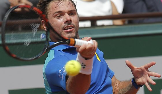 FILE - In this June 11, 2017, file photo, Switzerland's Stan Wawrinka returns the ball to Spain's Rafael Nadal during their final match of the French Open tennis tournament at Roland Garros stadium, in Paris. Wawrinka won at the Australian Open in 2014, the French Open in 2015 and the U.S. Open in 2016, but never made it past the quarterfinals at Wimbledon. (AP Photo/Michel Euler, File)
