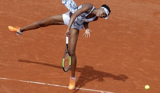 FILE - In this June 4, 2017, file photo, Venus Williams serves against Timea Bacsinszky during their fourth round match of the French Open tennis tournament at Roland Garros stadium, in Paris. The two past winners in the upcoming Wimbledon field are Venus Williams, a five-time champion, and Petra Kvitova, a two-time champ. (AP Photo/Michel Euler, File)