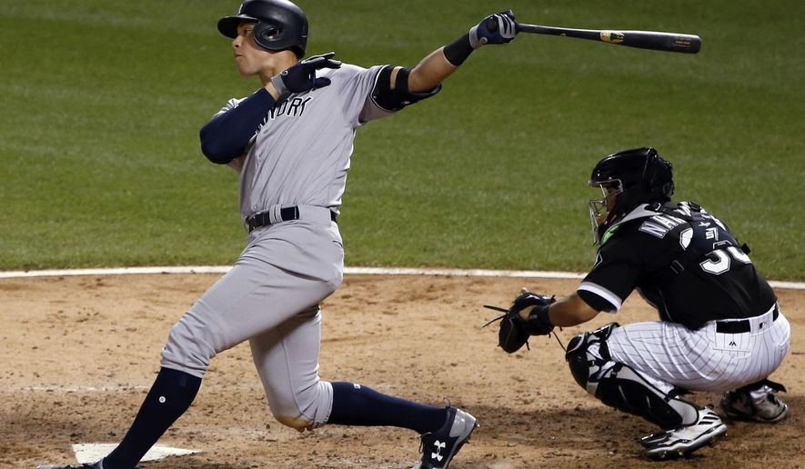 New York Yankees' Aaron Judge watches his two-run home run during the sixth inning of the team's baseball game against the Chicago White Sox, Wednesday, June 28, 2017, in Chicago. (AP Photo/Nam Y. Huh)