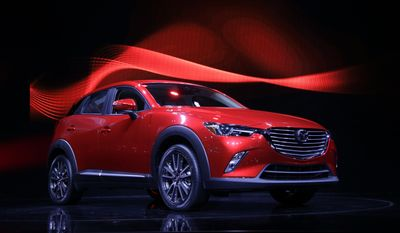 In this Nov. 19, 2014, file photo, the 2016 Mazda CX-3 is unveiled at the Los Angeles Auto Show, in Los Angeles. Mazda is recalling nearly 228,000 cars in the U.S. because the parking brake may not fully release or could fail to hold the cars, increasing the risk of a crash. The recall covers certain Mazda 6 cars from the 2014 and 2015 model years and the Mazda 3 from 2014 through 2016. (AP Photo/Jae C. Hong, File)