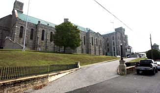 This Sept. 10, 2007, file photo shows the Kentucky State Penitentiary in Eddyville, Ky. Officials say Friday, June 30, 2017, that Kentucky's only maximum security prison is on lockdown after inmates attacked eight workers. Department of Corrections spokeswoman Lisa Lamb told media that 16 inmates attacked the workers Thursday afternoon near a canteen line in the yard of the Kentucky State Penitentiary. (AP Photo/Daniel R. Patmore, File)