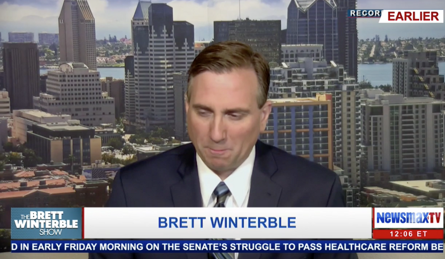 Brett Winterble, a NewsmaxTV host, is shown in this screen capture from the network's internet livestream. Newsmax TV has been re-added to the DirecTV lineup, the channel announced Friday. The conservative-leaning news network is also now available on AT&T's U-Verse service. (NewsmaxTV.com)