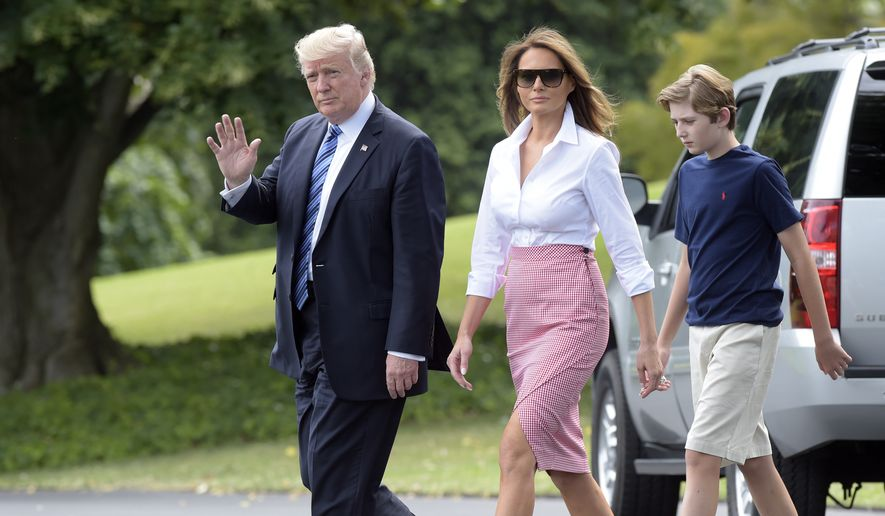 President Donald Trump, first lady Melania Trump, and their son and Barron Trump, walk on the South Lawn as they leave the White House in Washington, Friday, June 30, 2017, for a short trip to Andrews Air Force Base, Md., then onto Bedminster, N.J.  (AP Photo/Susan Walsh)