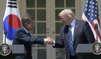 President Donald Trump and South Korean President Moon Jae-in shakes hands in the Rose Garden of the White House in Washington, Friday, June 30, 2017, after making statements. (AP Photo/Susan Walsh)