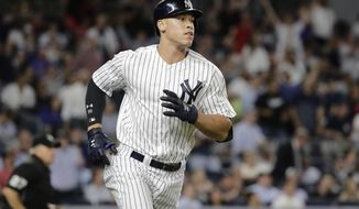 FILE - In this June 20, 2017, file photo, New York Yankees' Aaron Judge runs the bases after hitting a home run against the Los Angeles Angels in a baseball game in New York. Time to make the tough calls on which players warrant selection to the upcoming All-Star Game in Miami. Rest assured, rookie sensation Judge and perennial slugger Bryce Harper have secured their spots. (AP Photo/Frank Franklin II, File)