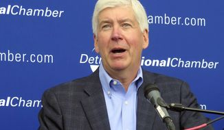 FILE - In this May 31, 2017, file photo, Michigan Gov. Rick Snyder speaks at the Detroit Regional Chamber's annual policy conference on Mackinac Island, Mich. Snyder vetoed legislation on Friday, June 30, 2017, to require Michigan to create and sell an anti-abortion fundraising license plate, saying the politically contentious bill would have divided residents. (AP Photo/David Eggert, File)