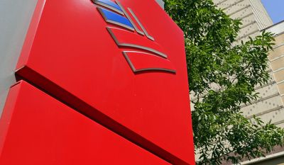 FILE - This Tuesday, July 7, 2015, file photo, shows Bank of America's corporate headquarters in Charlotte, N.C. Buffett's Berkshire Hathaway is buying 700 million shares in Bank of America, making Buffett the largest shareholder in two of the nation's largest banks. (AP Photo/Chuck Burton, File)