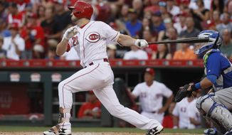 Cincinnati Reds' Adam Duvall hits a three-run home run off Chicago Cubs starting pitcher Mike Montgomery in the fourth inning of a baseball game, Friday, June 30, 2017, in Cincinnati. (AP Photo/John Minchillo)