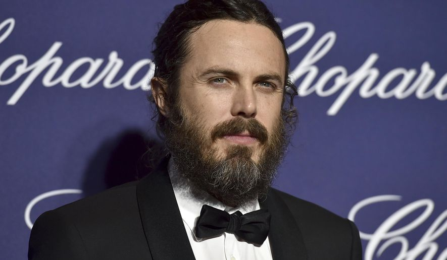 FILE - In this Monday, Jan. 2, 2017 file photo, Casey Affleck arrives at the 28th annual Palm Springs International Film Festival Awards Gala in Palm Springs, Calif. An annual international film festival in the western Czech spa town of Karlovy Vary is kicking off with awards for Oscar-nominated actress Uma Thurman, Academy Award winner Casey Affleck and film composer James Newton Howard on Friday, June 30, 2017. (Photo by Jordan Strauss/Invision/AP, File)