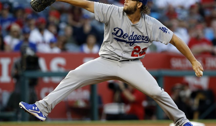 Los Angeles Dodgers starting pitcher Clayton Kershaw winds up during the third inning of the team's baseball game against the Los Angeles Angels in Anaheim, Calif., Thursday, June 29, 2017. (AP Photo/Alex Gallardo)