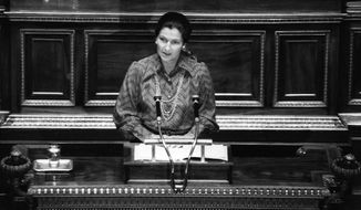 In this Dec. 13, 1974 file photo, French Health Minister Simone Veil speaks about abortion law at the French National Assembly in Paris. Simone Veil, a Nazi death camp survivor and prominent French politician who spearheaded abortion rights, dies at age 89. (AP Photo/Eustache Cardenas, File)