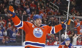 FILE - In this March 12, 2017, file photo, Edmonton Oilers left wing Milan Lucic celebrates a goal against the Montreal Canadiens during the second period of an NHL hockey game in Edmonton, Alberta. When the puck drops on NHL free agency Saturday, some teams will hit and some will miss. It happens every summer. The Oilers signed Lucic to a seven-season, $42 million contract a year ago and he panned out, helping the franchise reach the playoffs for the first time since 2006. (Jason Franson/The Canadian Press via AP, File)