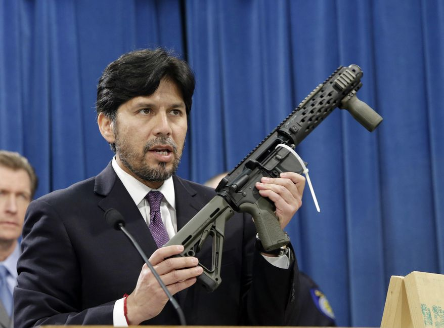 FILE - In this Jan. 13, 2014 file photo, California State Sen. Kevin de Leon, D-Los Angeles, displays a homemade fully automatic rifle, confiscated by the Department of Justice, at the Capitol in Sacramento, Calif. De Leon, who may seek higher office when he is termed out of office next year and has championed gun regulations, was dealt a setback when a federal judge blocked a law set to take effect Saturday that would have barred gun owners from possessing high-capacity ammunition magazines.(AP Photo/Rich Pedroncelli, file)