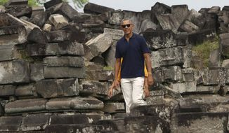 Former U.S. President Barack Obama walks during his visit to Prambanan Temple in Yogyakarta, Indonesia, Thursday, June 29, 2017. Obama and his family are currently on vacation in the country where he lived for several years as a child. (AP Photo)