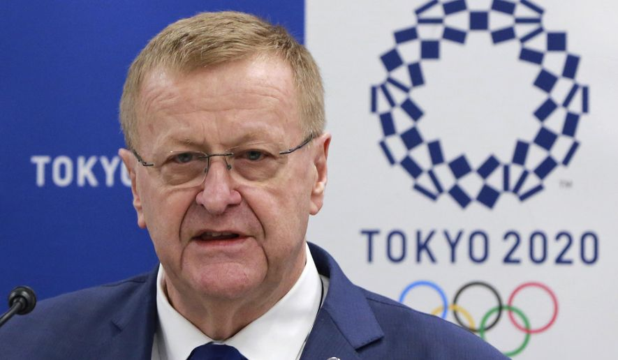 International Olympic Committee (IOC) Vice President John Coates answers questions from a journalist during an IOC-Tokyo 2020 joint press conference in Tokyo Friday, June 30, 2017. Coates said the addition of new sports at the 2020 Tokyo Olympics will attract youth and create gender equality without driving up costs. In an effort to give the games a more youthful and urban appeal, the IOC has added 3-on-3 basketball and BMX Freestyle cycling to the Tokyo program for a net increase of 15 gold medals for a 321-event program. (AP Photo/Eugene Hoshiko)