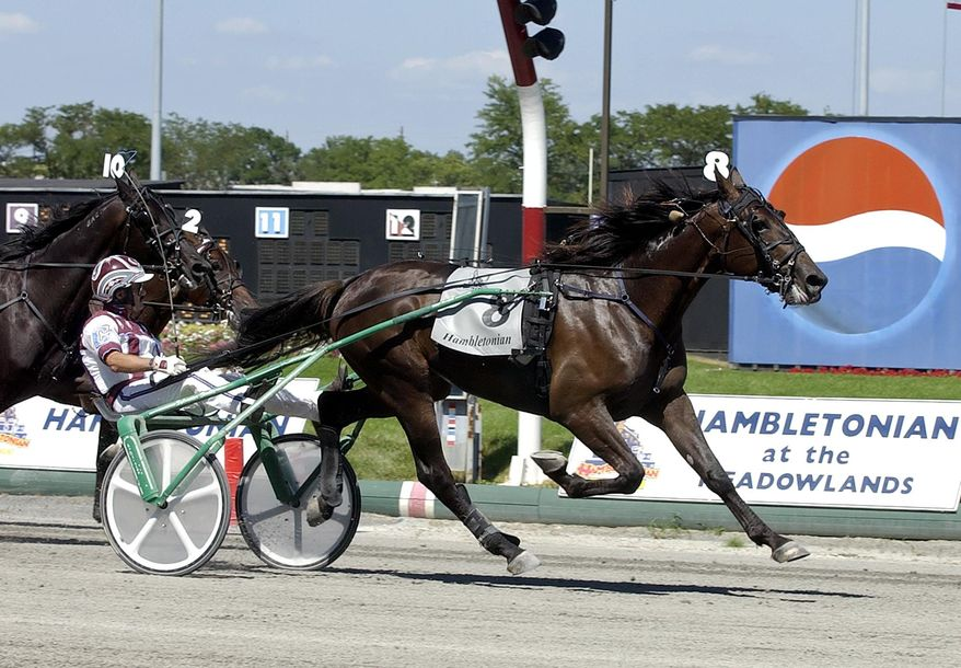 FILE - In this Aug. 5, 2006, file photo, Glidemaster, driven by John Campbell, wins the Hambletonian at Meadowlands Racetrack in East Rutherford, N.J. Campbell bids farewell to the Meadowlands, making his final drives at the track that helped the Hall of Famer become harness racing's career leader in purses. The 62-year-old Campbell is scheduled to drive in five races at the Meadowlands Racetrack on Friday night, June 30, 2017. (AP Photo/Bill Kostroun, File)