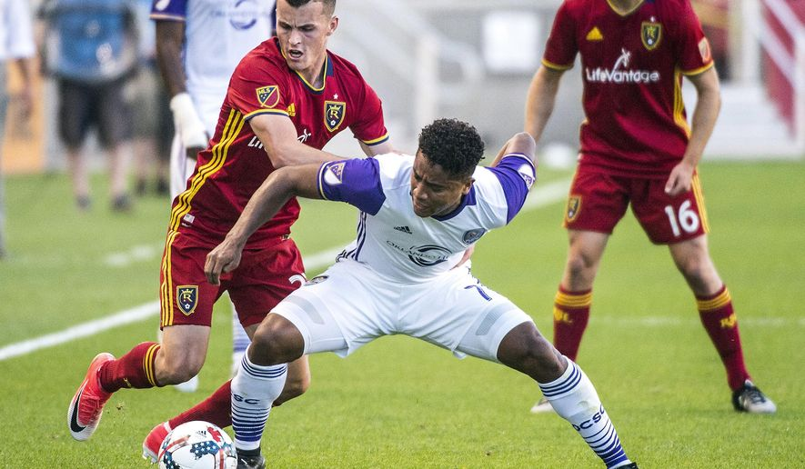 Real Salt Lake forward Brooks Lennon, left, and Orlando City SC midfielder Cristian Higuita (7) go for the ball during an MLS soccer game in Sandy, Utah, Friday, June 30, 2017. (Chris Detrick/The Salt Lake Tribune via AP)