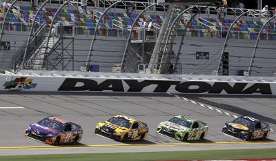 Denny Hamlin (11) leads Matt Kenseth (20) , Kyle Busch (18) and Martin Truex Jr. (78) though a lap during a NASCAR cup auto racing practice at Daytona International Speedway, Thursday, June 29, 2017, in Daytona Beach, Fla. (AP Photo/John Raoux)