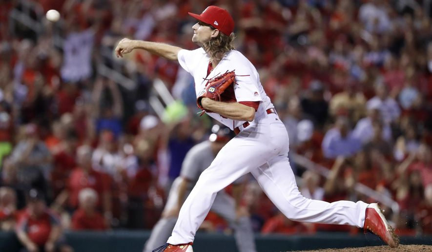 St. Louis Cardinals starting pitcher Mike Leake throws during the eighth inning of the team's baseball game against the Washington Nationals on Friday, June 30, 2017, in St. Louis. (AP Photo/Jeff Roberson)