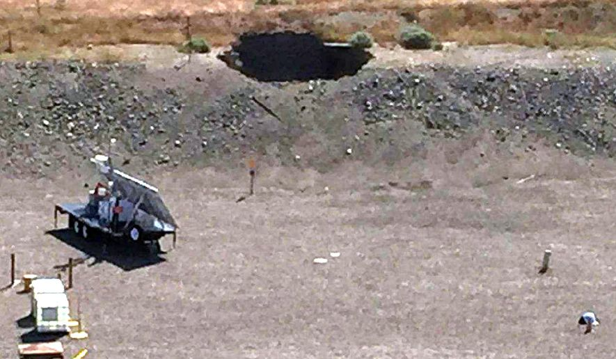 FILE - This May 9, 2017, file photo, provided by the U.S. Department of Energy, shows a 20-foot by 20-foot hole in the roof of a storage tunnel at the Hanford Nuclear Reservation near Richland, Wash. The U.S. Department of Energy says there is a high risk that a second tunnel filled with radioactive waste might collapse on the Hanford site. This section of tunnel partially collapsed at the site, forcing some 3,000 workers to seek shelter for a few hours. (U.S. Department of Energy via AP, File)