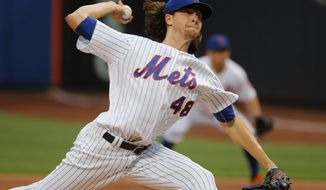 New York Mets pitcher Jacob deGrom delivers to the Philadelphia Phillies during the first inning of a baseball game, Friday, June 30, 2017, in New York. (AP Photo/Julie Jacobson)
