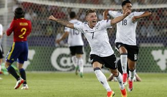 Germany's Max Meyer, front, celebrates winning the Euro Under 21 final soccer match between Germany and Spain in Krakow, Poland, Friday, June 30, 2017. Germany defeated Spain by 1-0. (AP Photo/Czarek Sokolowski)