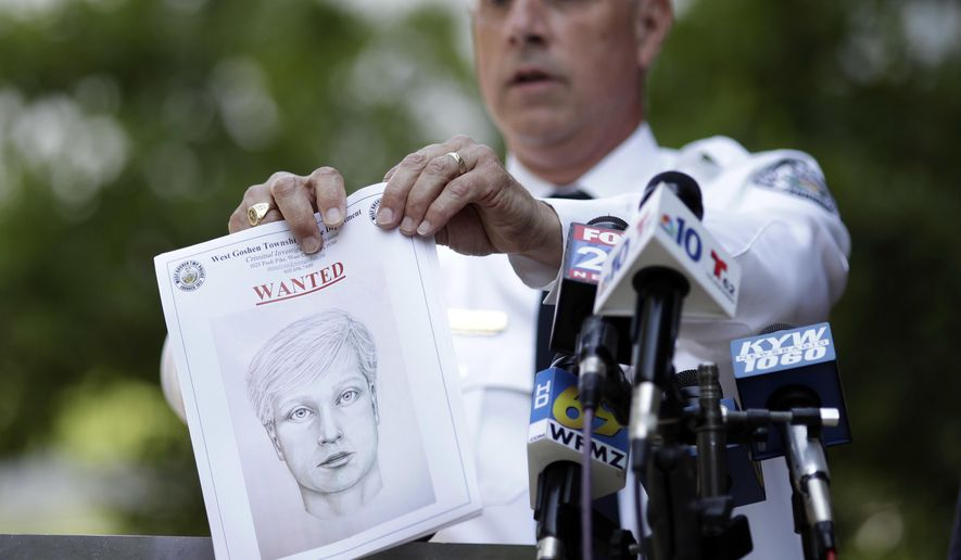 West Goshen Police Chief Joseph Gleason holds a sketch of a suspected road rage shooter during a news conference outside police headquarters, Friday, June 30, 2017, in West Goshen, Pa. The man is suspected of shooting of high school graduate Bianca Roberson, 18, in the head, killing her, as the two tried to merge into a single lane on, authorities said. (AP Photo/Matt Slocum)