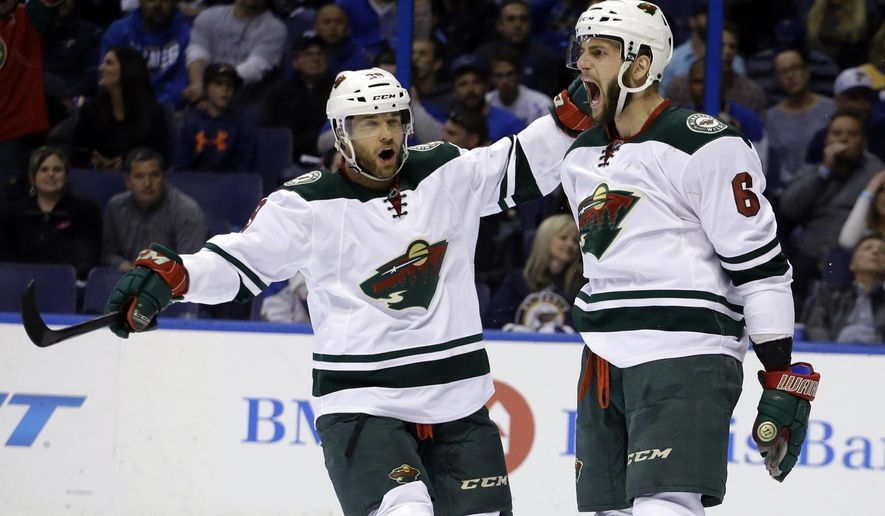 FILE - In this April 24, 2015, file photo, Minnesota Wild's Jason Pominville, left, congratulates teammate Marco Scandella after he scored during the first period in Game 5 of an NHL hockey first-round playoff series against the St. Louis Blues, in St. Louis. Former Sabres captain Jason Pominville is returning to Buffalo after being acquired along with defenseman Marco Scandella in a four-player trade with the Minnesota Wild, Friday, June 30, 2017. (AP Photo/Jeff Roberson, File)