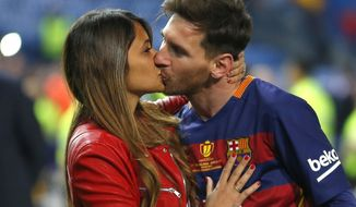 FILE - In this May 22, 2016 file photo, Barcelona's Lionel Messi kisses his girlfriend Antonella Roccuzzo, after winning the final of the Copa del Rey soccer match against Sevilla FC at the Vicente Calderon stadium in Madrid. Messi will be marrying 29-year-old Roccuzzo, his childhood friend and mother of his two children on Friday, June 30, 2017, in his hometown of Rosario, Argentina. (AP Photo/Francisco Seco/ File)