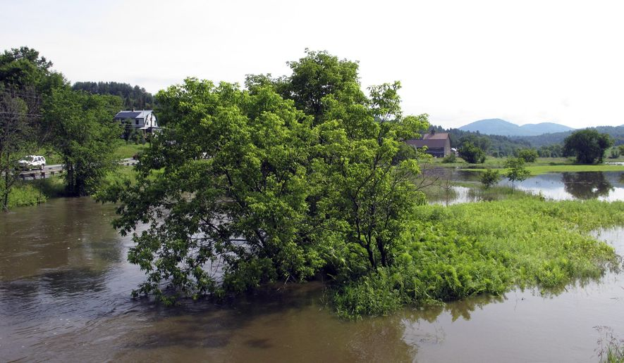A section of the Winooski River floods a farm field in Marshfield, Vt., on Friday, June 30, 2017. The National Weather Service says heavy rain falling on saturated soil with more to come is causing some flooding and road closures in low-lying areas of northern Vermont and parts of upstate New York. (AP Photo/Lisa Rathke)