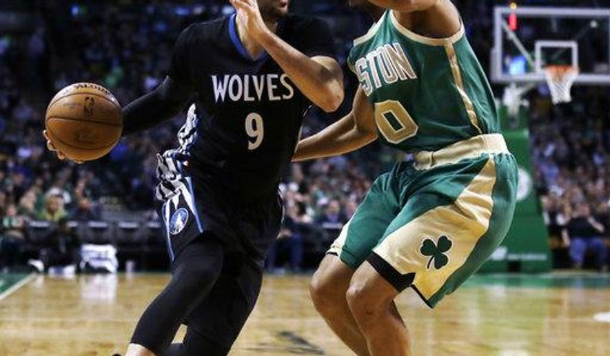 FILE - In this March 15, 2017, file photo, Minnesota Timberwolves' Ricky Rubio (9) tries to drive past Boston Celtics' Avery Bradley (0) during the second half of an NBA basketball game in Boston. The Timberwolves have reached an agreement to Rubio to the Utah Jazz to clear salary cap space for a big run in free agency. A person with direct knowledge of the deal tells The Associated Press the two sides agreed to the move on Friday, June 30, 2017, hours before free agency opened. (AP Photo/Charles Krupa, File)