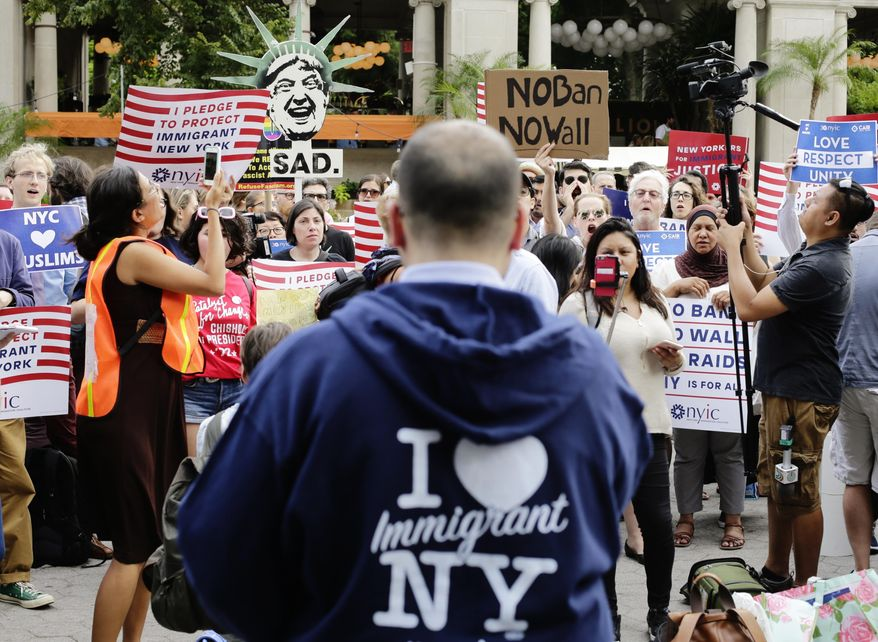 Protesters of a travel ban gather in Union Square, Thursday, June 29, 2017, in New York. A scaled-back version of President Donald Trump's travel ban takes effect Thursday evening, stripped of provisions that brought protests and chaos at airports worldwide in January yet still likely to generate a new round of court fights. (AP Photo/Frank Franklin II)
