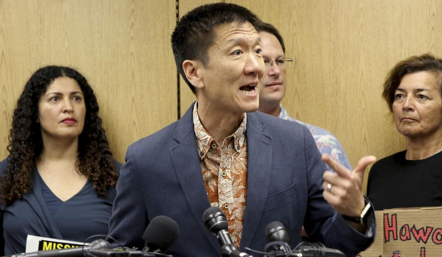 Hawaii Attorney General Douglas Chin speaks at a news conference about Hawaii's lawsuit challenging President Donald Trump's travel ban, Friday, June 30, 2017 in Honolulu. Chin says the scaled-back version of Trump's travel ban has illogical standards for who should be prohibited from entering the country. Chin questioned why a stepbrother or stepsister should be allowed into the country but not a grandmother. The Trump administration set new criteria Thursday barring some citizens from six majority-Muslim countering from coming to the United States. (AP Photo/Caleb Jones)