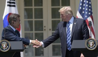 President Donald Trump and South Korean President Moon Jae-in shakes hands in the Rose Garden of the White House in Washington, Friday, June 30, 2017, where they made statements. (AP Photo/Susan Walsh)