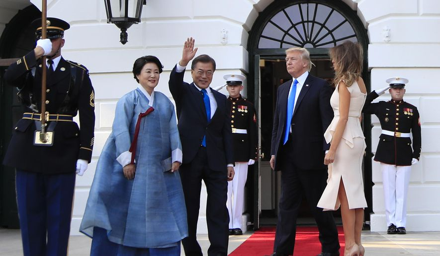 President Donald Trump and first lady Melania Trump welcome South Korean President Moon Jae-in and his wife Kim Jung-sook on the South Portico at the White House in Washington, Thursday, June 29, 2017. (AP Photo/Manuel Balce Ceneta)