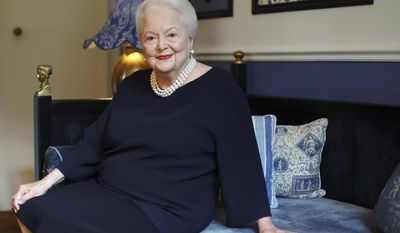 """FILE - In this June 18, 2016 file photo, U.S. actress Olivia de Havilland poses during an Associated Press interview, in Paris. de Havilland is launching her own sequel to the TV series """"Feud."""" The double Oscar-winning actress is suing FX Networks and producer Ryan Murphy's company, alleging unauthorized and false use of her name and invasion of privacy. The suit was filed in Los Angeles on Friday, June 30, 2017, one day before de Havilland turns 101. (AP Photo/Thibault Camus, File)"""