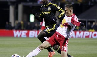 FILE - In this Nov. 22, 2015, file photo, New York Red Bulls defender Matt Miazga, right, works for the ball against Columbus Crew forward Kei Kamara during the first leg of the MLS soccer Eastern Conference championship in Columbus, Ohio. Miazga is with the U.S. national team for the first time in more than a year as the Americans prepare for a Saturday, July 1, exhibition against Ghana and the CONCACAF Gold Cup. (AP Photo/Paul Vernon)