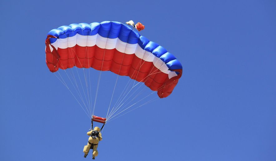 A federal smokejumper participates in a practice jump west of Albuquerque, N.M., on June 29, 2017. Federal agencies called for a boost in the number of resources in the Southwest due to the persistent fire danger, resulting in smokejumpers from Idaho and Montana being assigned to the region. (AP Photo/Susan Montoya Bryan)