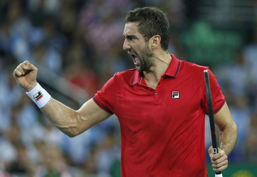 FILE - In this Nov. 27, 2016, file photo, Croatia's Marin Cilic gestures after winning a point against Argentina's Juan Martin Del Potro during their Davis Cup finals tennis singles match in Zagreb, Croatia. Roger Federer, Novak Djokovic, Rafael Nadal and Andy Murray have combined to win the past 14 Wimbledon men's titles. If someone else is going to take home the title, Cilic is a possible candidate. (AP Photo/Darko Vojinovic, File)