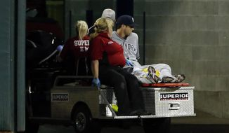 New York Yankees' Dustin Fowler is taken off the field after he was injured during the first inning of the team's baseball game against the Chicago White Sox on Thursday, June 29, 2017, in Chicago. (AP Photo/Nam Y. Huh)