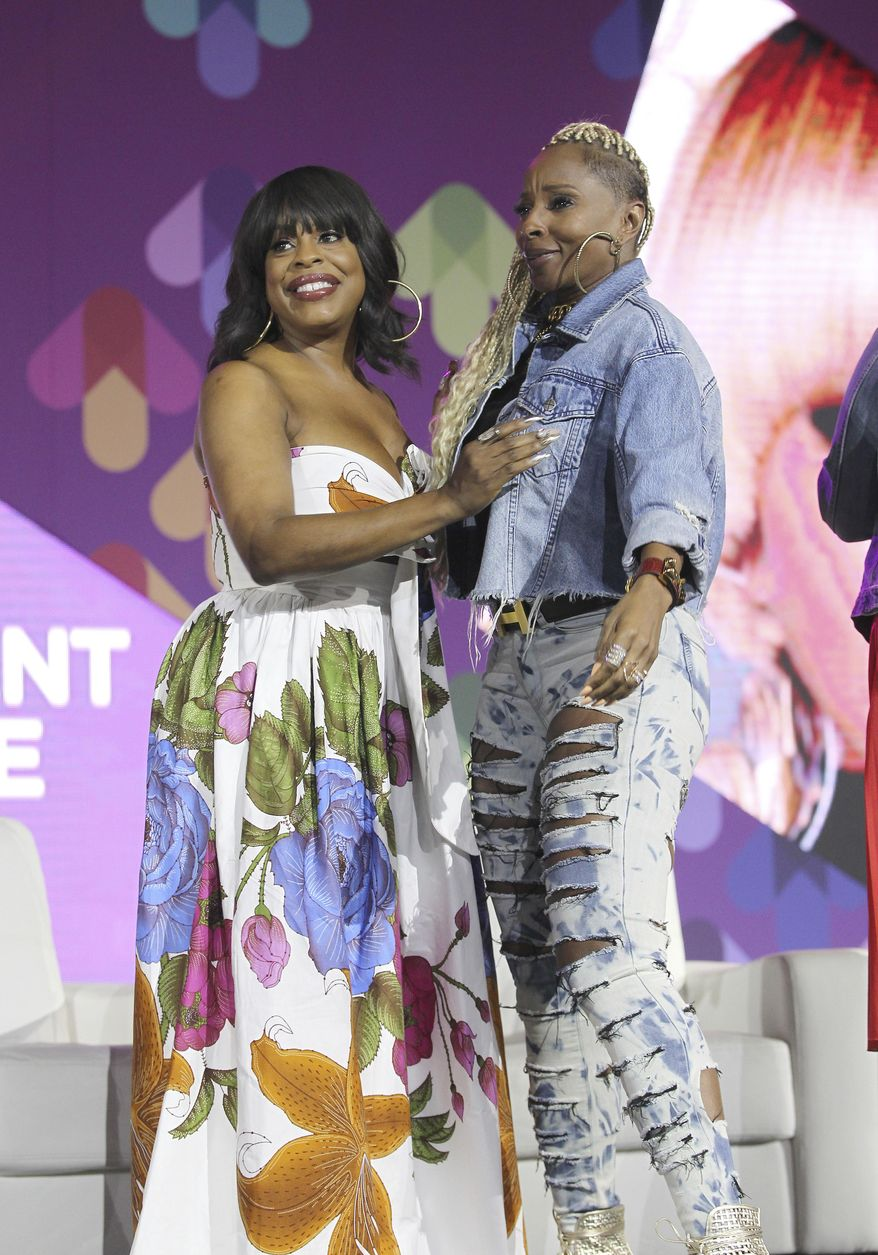 Actress Nicey Nash and singer Mary J. Blige is seen at Essence Empowerment experience during the Essence Music Festival at the Ernest N. Morial Convention Center on Friday, Jun 30, 2017, in New Orleans, LA. (Photo by Donald Traill/Invision/AP)