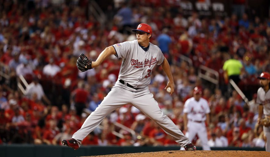 Washington Nationals pitcher Sammy Solis throws during the eighth inning of a baseball game against the St. Louis Cardinals Saturday, July 1, 2017, in St. Louis. (AP Photo/Jeff Roberson)