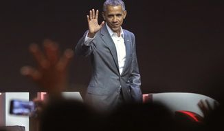 Former U.S. President Barack Obama waves at the audience after delivering his speech during the 4th Congress of the Indonesian Diasporas in Jakarta, Indonesia, Saturday, July 1, 2017. (AP Photo/Achmad Ibrahim)