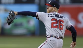 Atlanta Braves pitcher Mike Foltynewicz works against the Oakland Athletics during the first inning of a baseball game Friday, June 30, 2017, in Oakland, Calif. (AP Photo/Ben Margot)