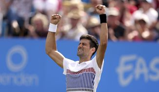 Serbia's Novak Djokovic celebrates winning the match against France's Gael Monfils in the Men's Singles Final, of the AEGON International tennis tournament at Devonshire Park, Eastbourne, England, Saturday, July 1, 2017. (Steven Paston/PA via AP)
